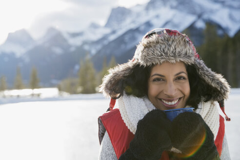 Portrait of smiling woman drinking hot cocoa - HEROF10155