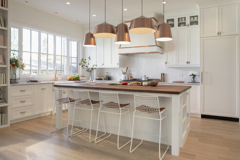 White home showcase interior kitchen with copper pendant lights - HEROF10185