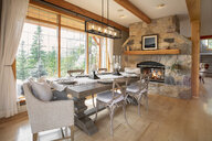 Home showcase interior dining room with stone fireplace - HEROF10197