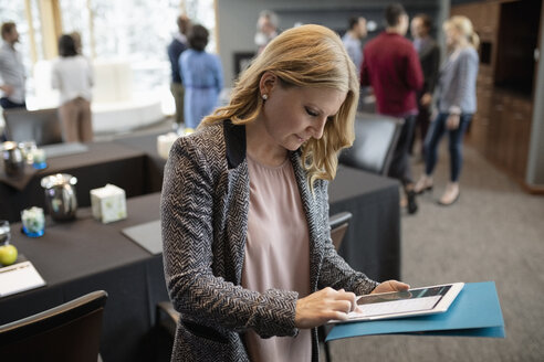Businesswoman using digital tablet at conference - HEROF10352