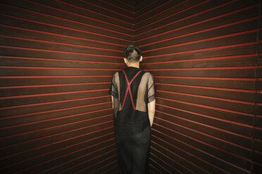 Male millennial standing in corner at nightclub - HEROF10504