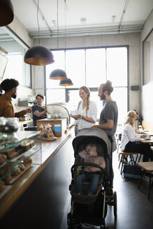 Young family at cafe - HEROF11045
