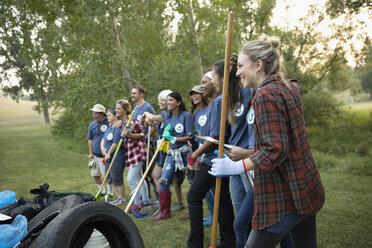 Volunteers meeting, preparing in park - HEROF11111