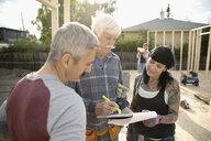 Volunteers meeting, helping build house - HEROF11135