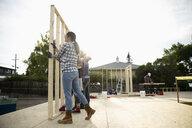 Volunteers lifting frame, helping build house - HEROF11141