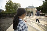 Volunteers carrying frame, helping build house - HEROF11144