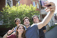 Carefree millennials posing for selfie on sidewalk - HEROF11267