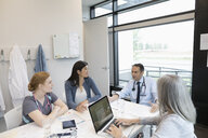 Doctors and nurse meeting in clinic office - HEROF11513
