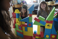 Girl friends playing with building blocks - HEROF11708
