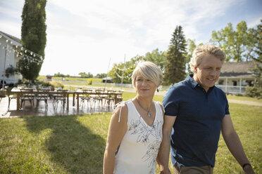 Mature couple walking on rural farm - HEROF11906