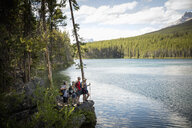Mature couples hiking in lakeside forest, Alberta, Canada - HEROF11948