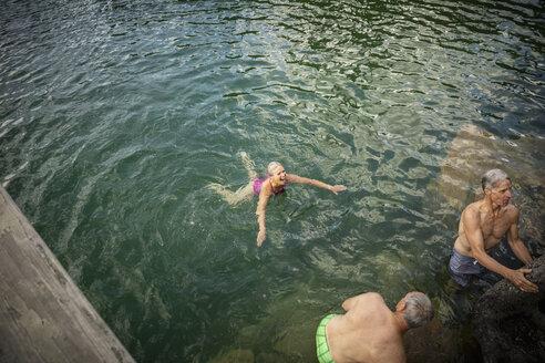 Mature friends swimming in lake - HEROF11987