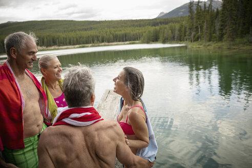 Mature couples standing at lakeside, Alberta, Canada - HEROF11996