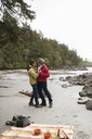 Affectionate active senior couple dancing on rugged beach - HEROF12005