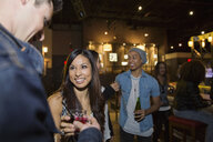 Friends drinking and talking at bar - HEROF12125