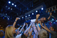 Man crowdsurfing at nightclub - HEROF12134