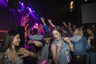 Friends dancing at music concert - HEROF12137