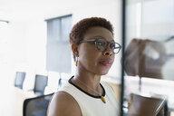 Focused businesswoman working in office - HEROF12230