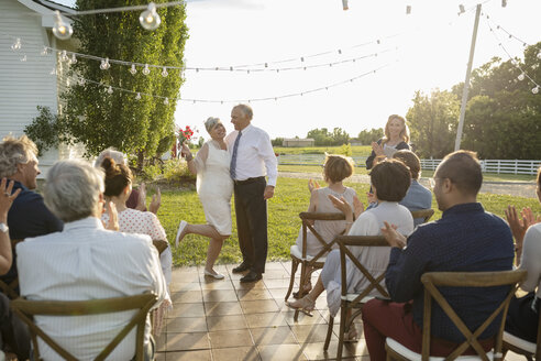 Senior bride and groom getting married in rural garden - HEROF12659