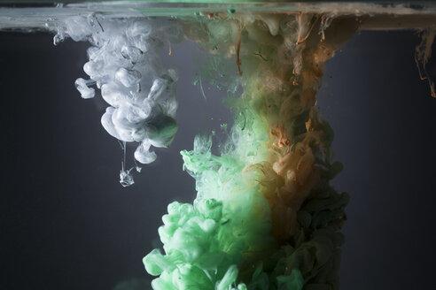 Creative green, orange and white liquid blending underwater - HEROF12719