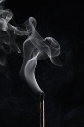 Extinguished matchstick smoke on black background - HEROF12728