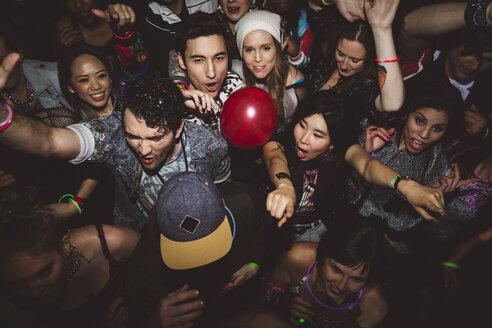 Carefree milennials dancing, partying in nightclub - HEROF12791