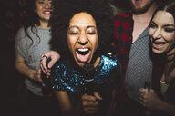 Exuberant young female millennial singing karaoke - HEROF12824