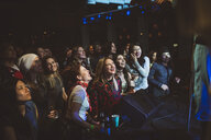 Enthusiastic crowd enjoying music concert - HEROF12848