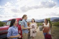 Vintner leading vineyard tour for women friends wine tasting - HEROF12980