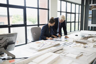Architects working at table in office - HEROF13175