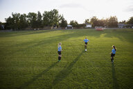 Middle school girl soccer teammates practicing on field - HEROF13409