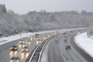 Germany, motorway in winter, icy road and traffic - CRF02827
