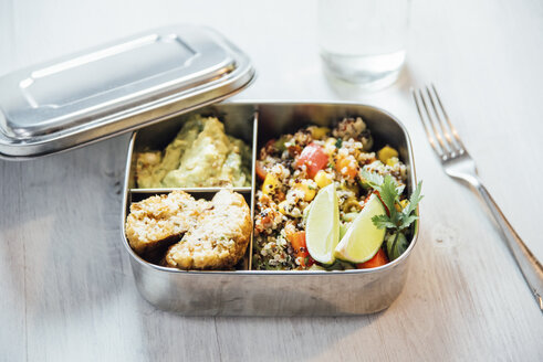 Bento box of quinoa salad with vegetables and lime, avocado cream and cauliflower dumplings - IPF00496