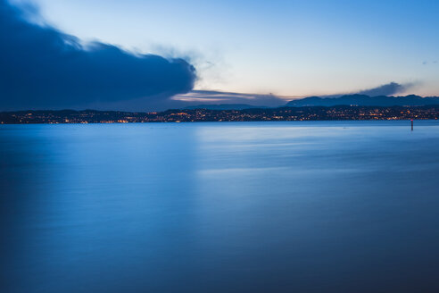 Italy, Lombardy, Sirmione, Garda lake at dusk on a cold winter day - FLMF00125