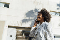 Beautiful woman walking in the city, talking on the phone - BOYF01317