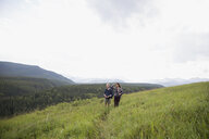 Senior couple hiking in remote rural field - HEROF13701