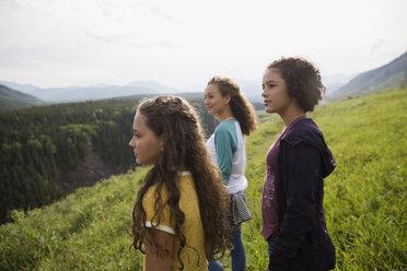 Teenage sisters looking at remote rural view - HEROF13710