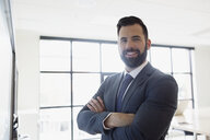 Portrait smiling brunette businessman with beard in conference room - HEROF13725