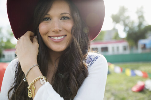 Portrait smiling young brunette woman wearing hat - HEROF13764