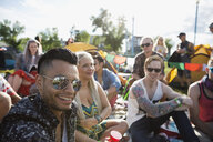 Portrait confident young men enjoying summer music festival - HEROF13941