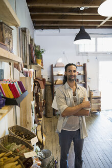Portrait confident male shop owner with arms crossed - HEROF14019