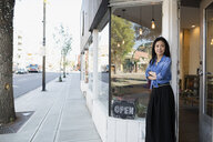 Portrait confident female shop owner in storefront doorway - HEROF14022