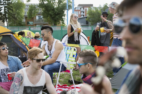 Young friends hanging out at summer music festival campsite - HEROF14070