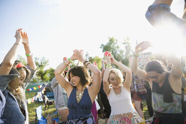 Young friends dancing at summer music festival - HEROF14130