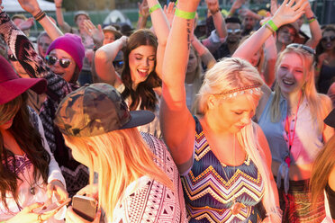 Young women dancing in crowd at summary music festival - HEROF14142
