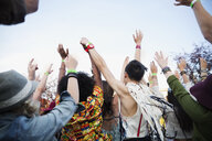 Young crowd cheering at summer music festival - HEROF14145