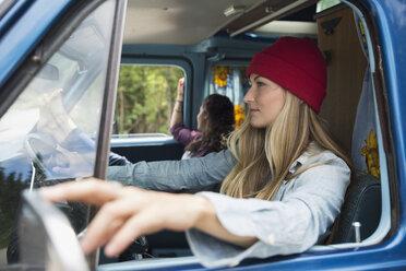 Woman driving camper van - HEROF14202