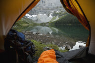 View of mountain and tranquil lake from inside of camping tent - HEROF14229