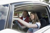Father teaching tween daughter how to drive car - HEROF14406