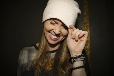 Playful, laughing, carefree female millennial in stocking cap - HEROF14508
